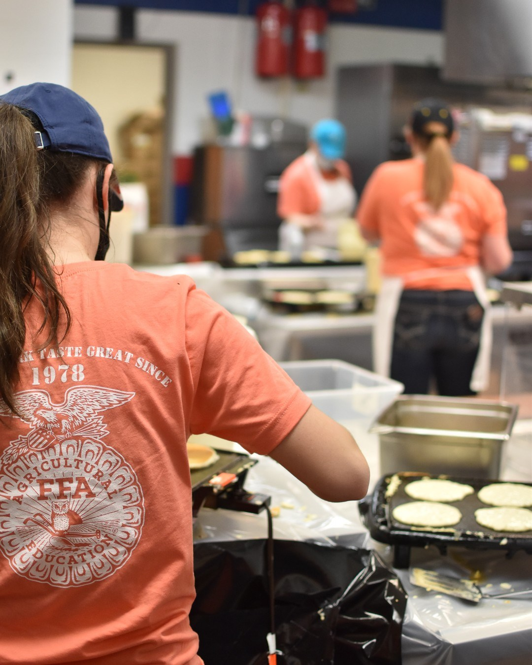 FFA chapter members prepare breakfast at its annual fundraiser.
