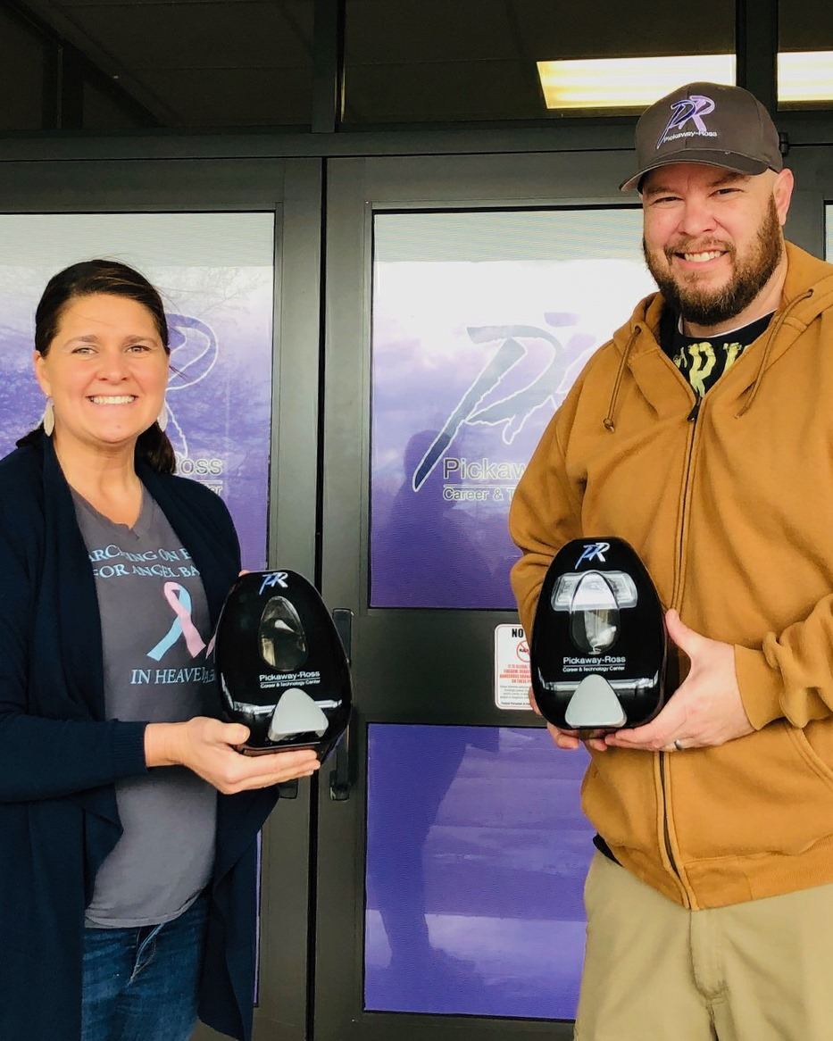 Leeann Puckett with GE's Peebles test operation facility, accepted a donation of hand sanitizer and other PPE from Jason Vesey in the spring. GE returned the favor recently.
