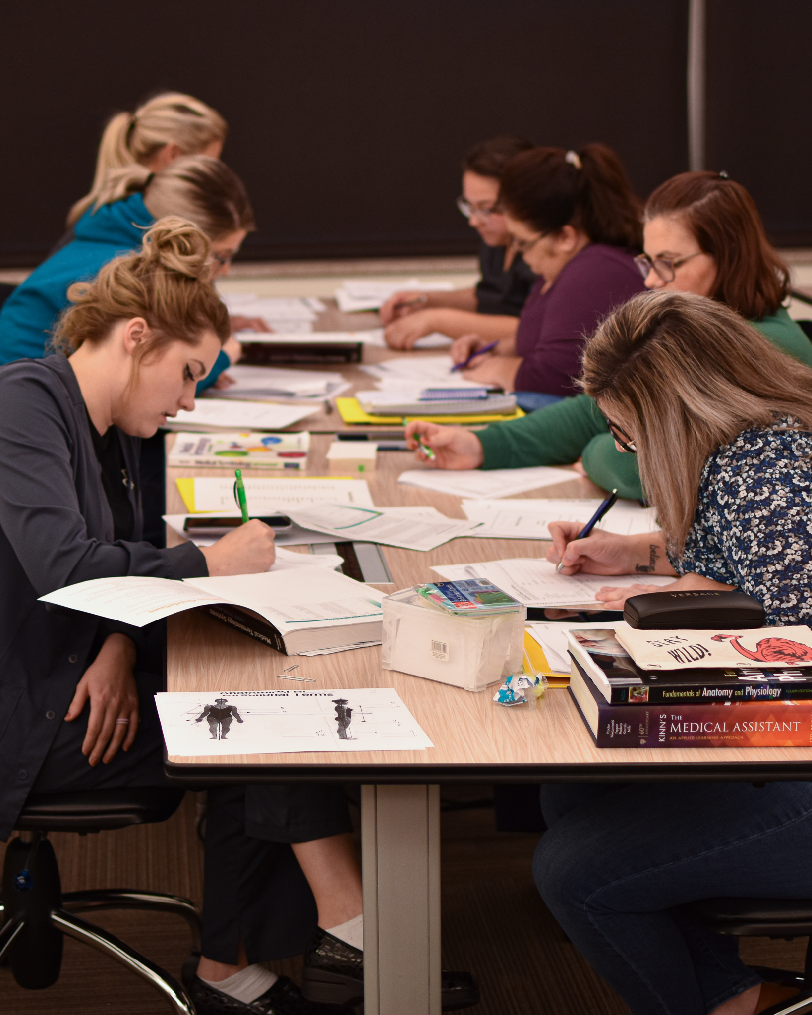 Medical Assisting students work on an assignment in the PACCAR Center.