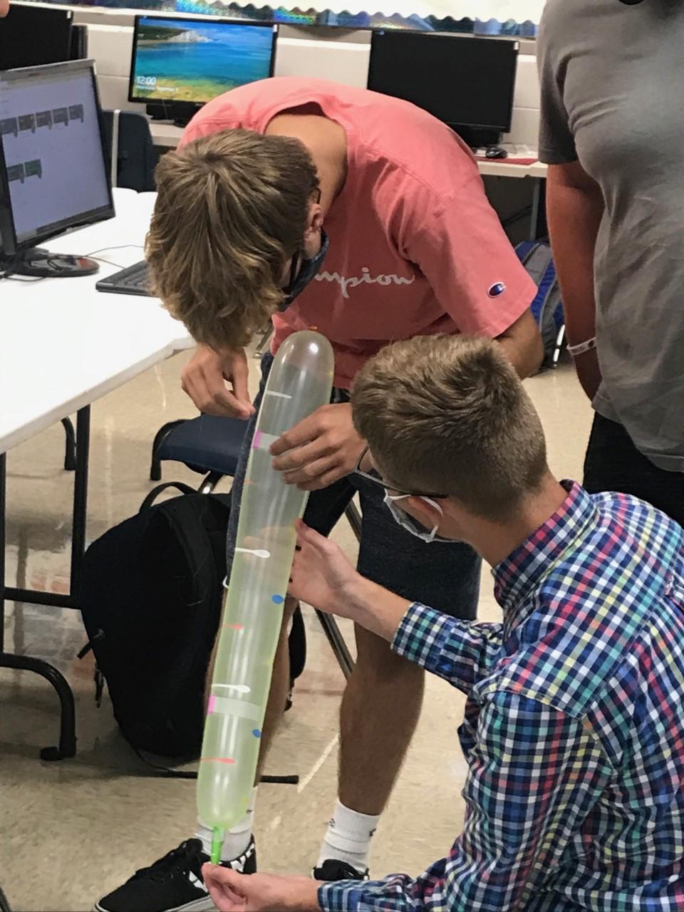 Students prepare a rocket in Zane Trace's Aviation class.