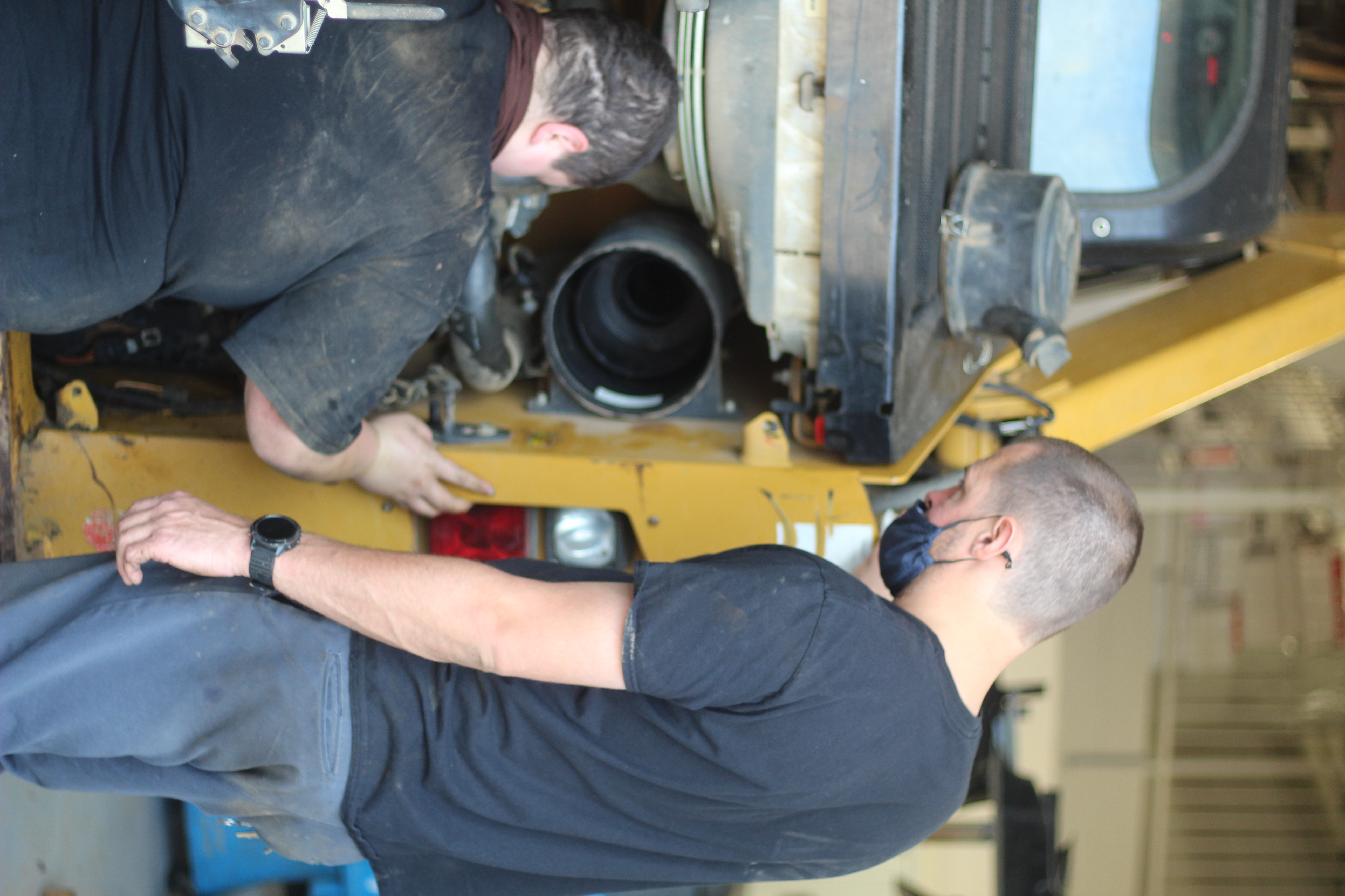 Instructor Michael Shepherd (right) works with a student in his Diesel & Heavy Truck Mechanics program.