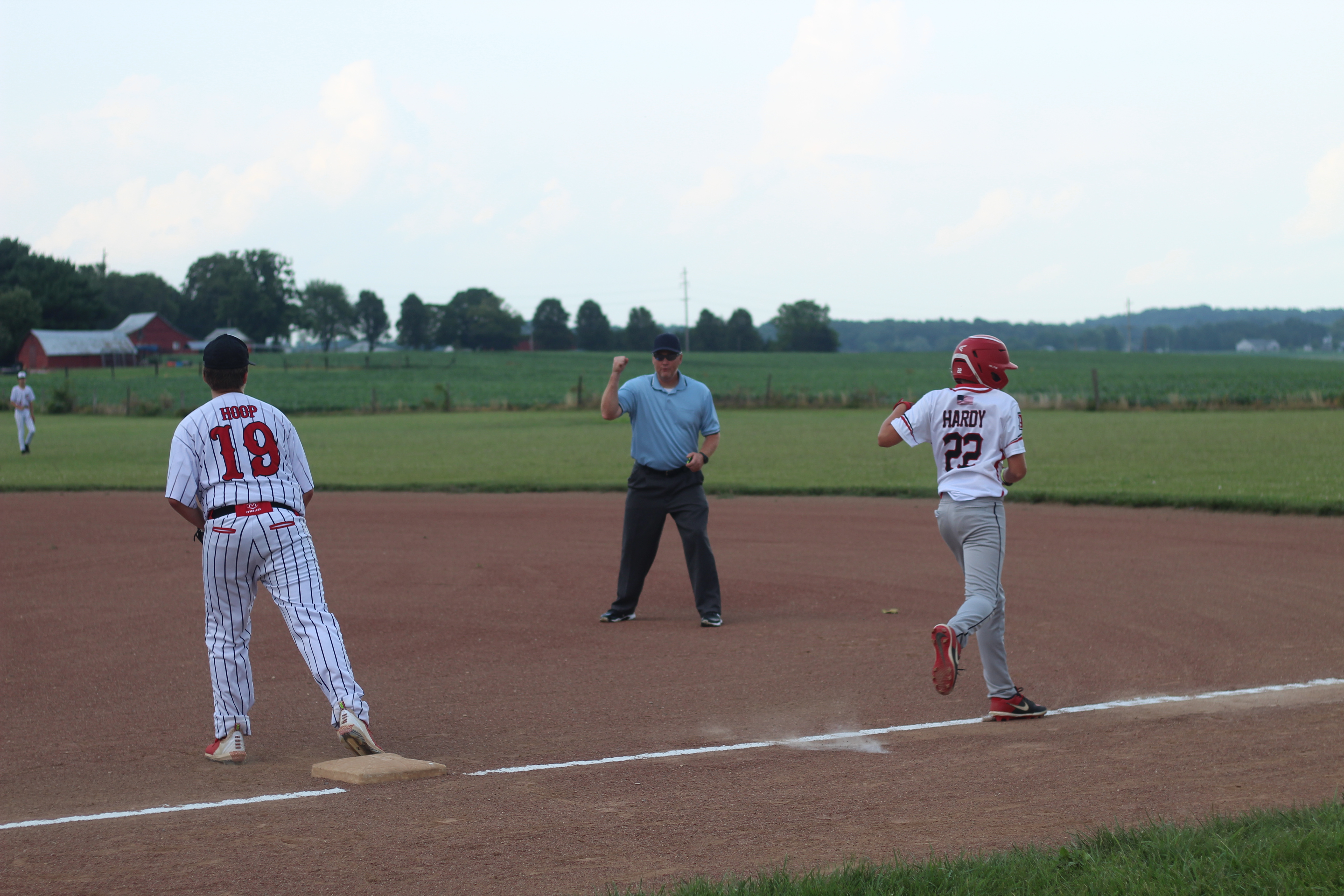 Aaron McManes makes a call at first during a game in July.